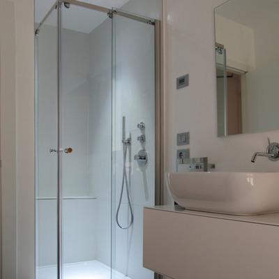 Cambiare porte doccia con apertura centrale ad angolo