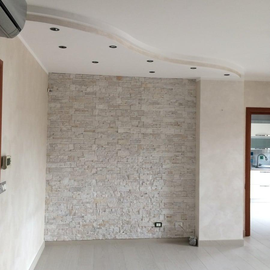 Rivestire pareti i materiali i prezzi e le idee for Rivestimento parete salotto