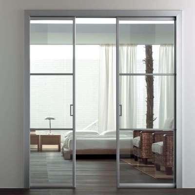 Convertire a porta scorrevole in vetro e alluminio