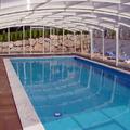Le coperture per piscine di design elegante, scorrevoli , Aquanova da Bologna