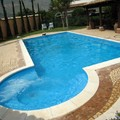 piscine a skimmer con isola relax