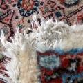 restauro angolo tappeto Mud