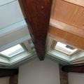 Ristrutturazione palazzetto intallazione lucernari domotizzati e travature in legno