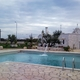 piscina a skimmer  pietra naturale e gres