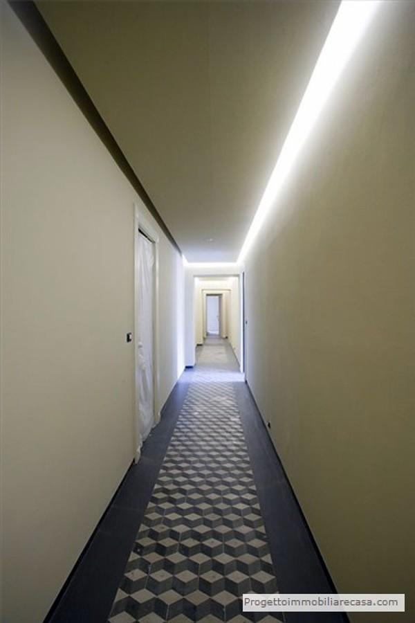 Corridoio in cementine originali e resina