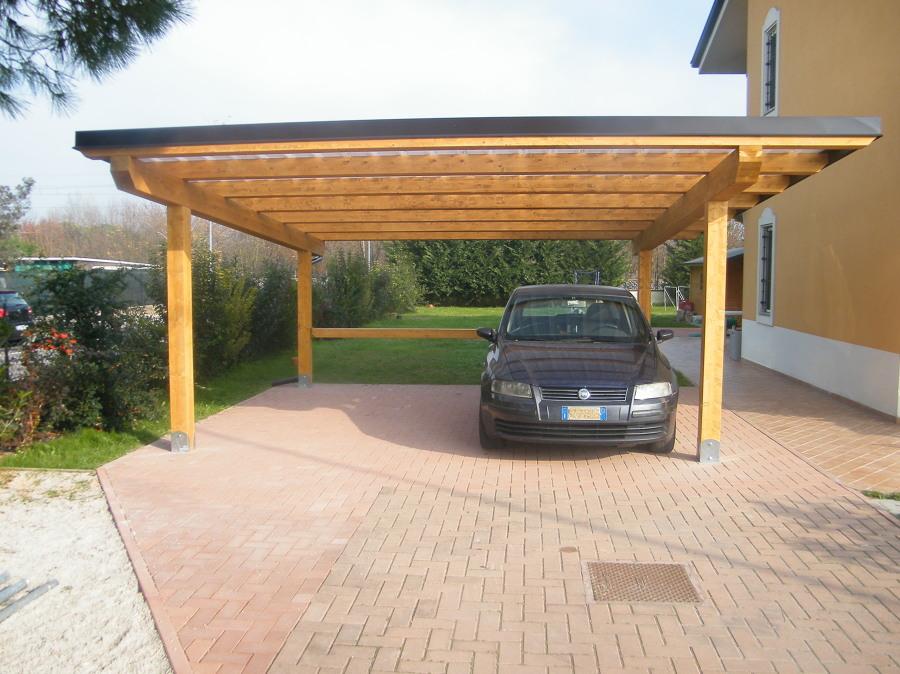 Foto tettoia per ricovero auto con copertura in - Archi per giardino ...