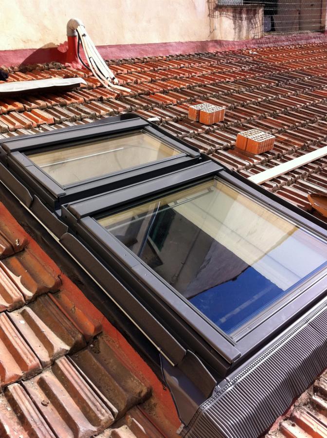 foto montaggio finestre velux sovrapposte de ediltecno