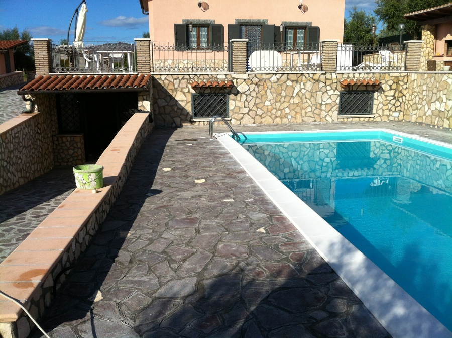 Foto pavimentazione in porfido e piscina de gieffe s r l for Pavimentazione della piscina