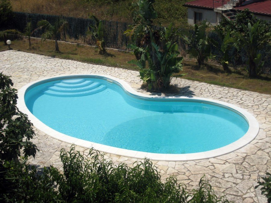 Foto piscine a skimmer a fagiolo di piscine systems for Piscine bois 9x5
