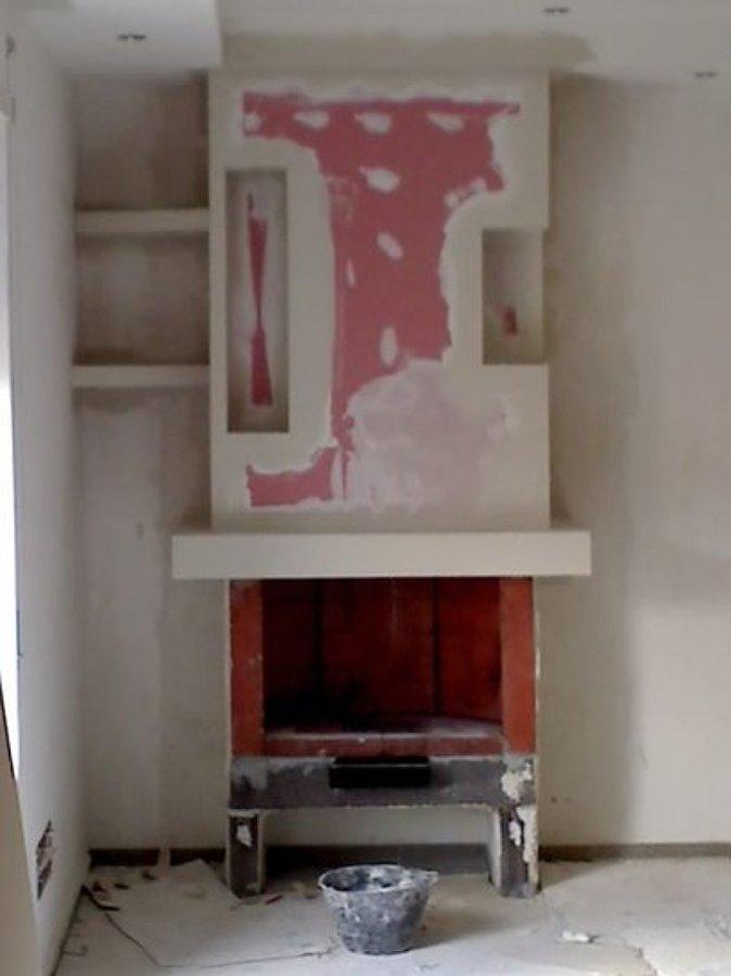 Casa moderna roma italy idee rivestimento camino for Rivestimento camino moderno