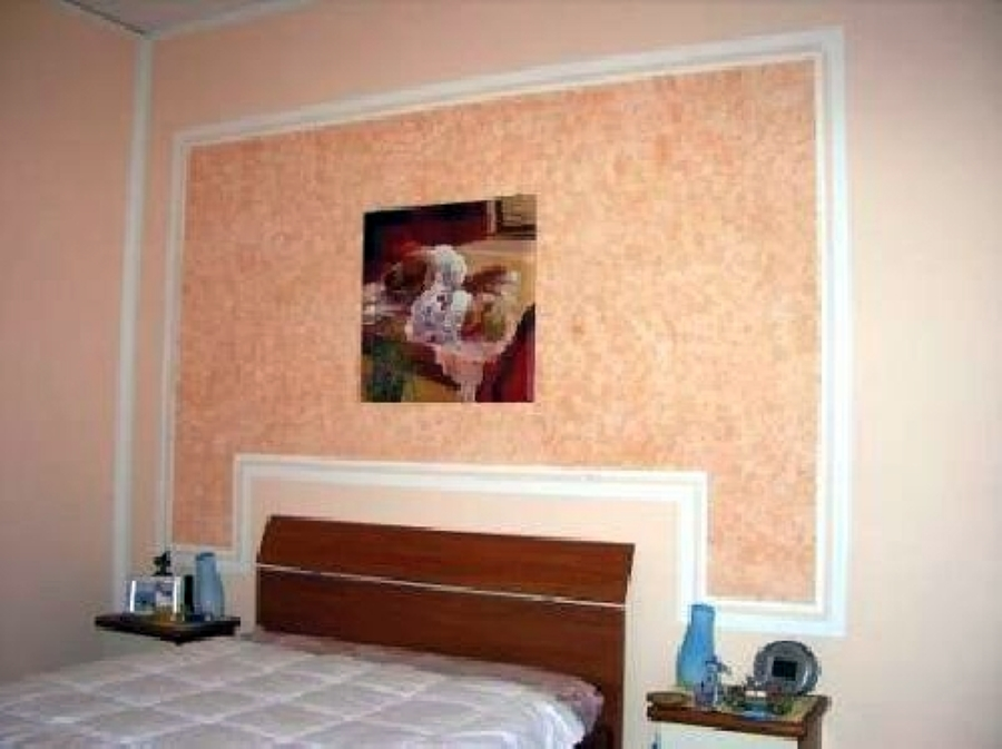Foto rivestimento con gesso in una parete letto di magma - Idee per dipingere casa ...