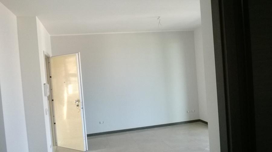 Foto: Sala con Parete Colorata di Colore Grigio di Imbianca & Colora ...