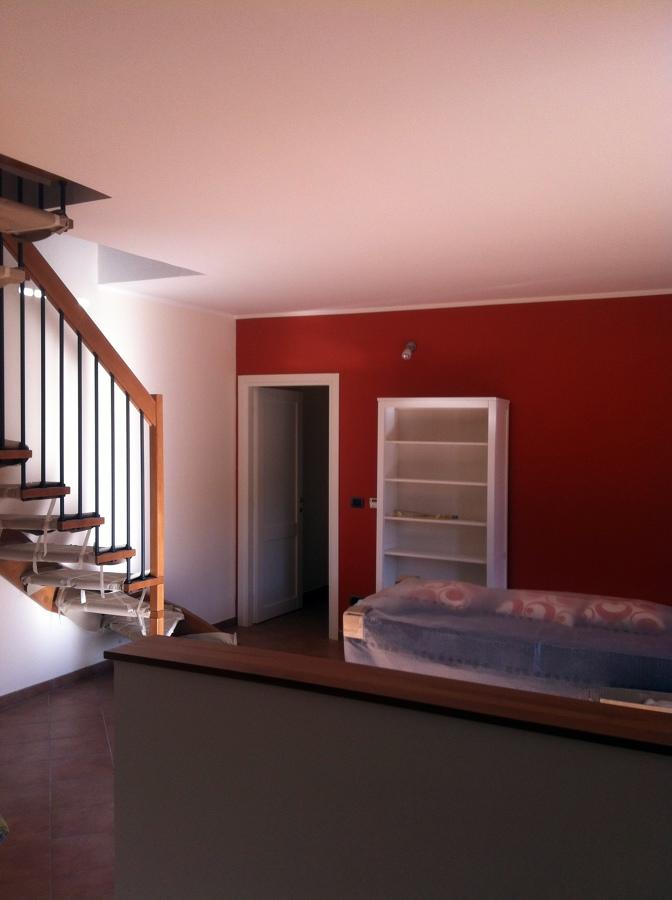 Foto soggiorno de decor fantasy 57396 habitissimo for Parete rossa soggiorno
