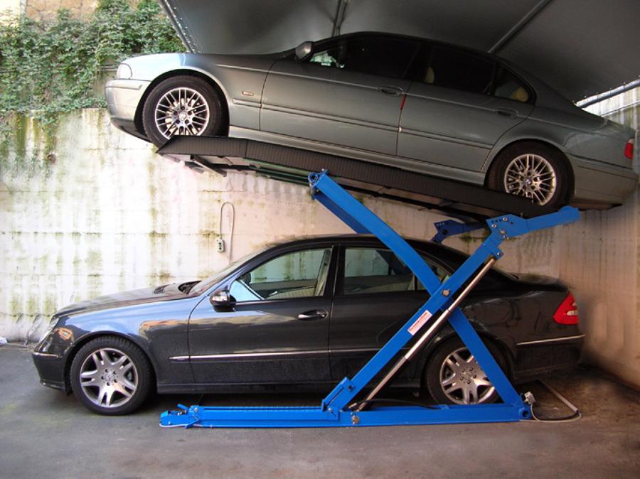 Foto sollevatori per auto a pantografo ragno di for 20 box auto in vendita