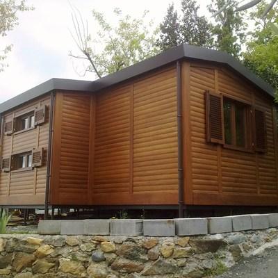 bungalow rivestito in legno Iroko