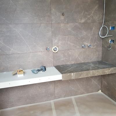 Realizzazione parete bagno con struttura porta lavabi