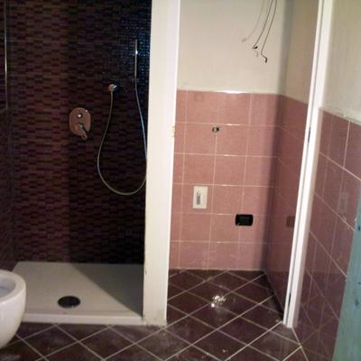 """Bagno con porta filo muro """"Modugno"""""""