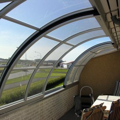 Chiusura scorrevole balcone / terrazza curvata da Aquanova da Bologna