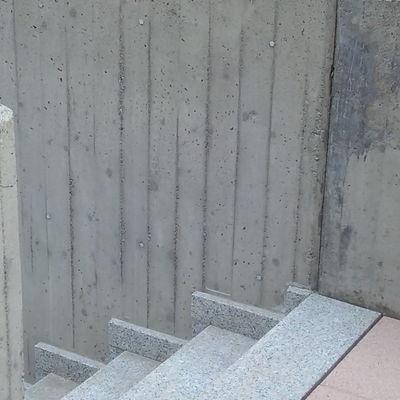 pulizia muro di cemento