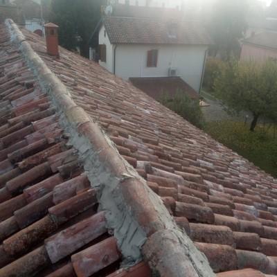 Sistemazione tetto con ganci fermacoppi