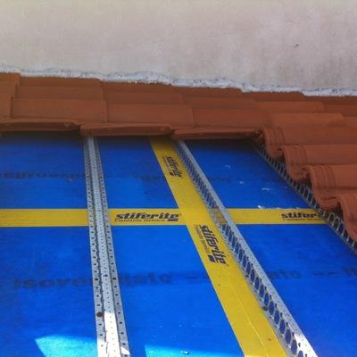 isolamento tetto con listello ferma tegole