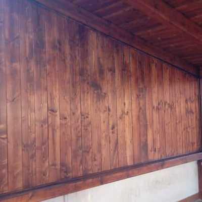 Veranda per posti auto con pannelli e grigliato laterali