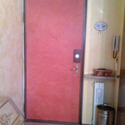 porta di ingresso in spatolato