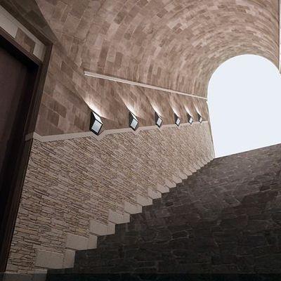 scalinata accesso cantina vini realizzata in travertino con volta a tutto sesto