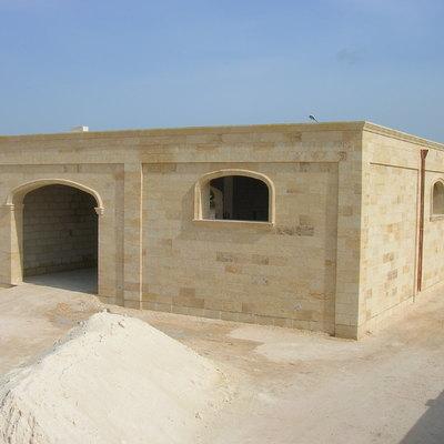 struttura in cemento rivestita in pietra a vista