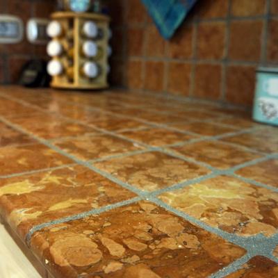 top cucina in ciotolo burattato di marmo