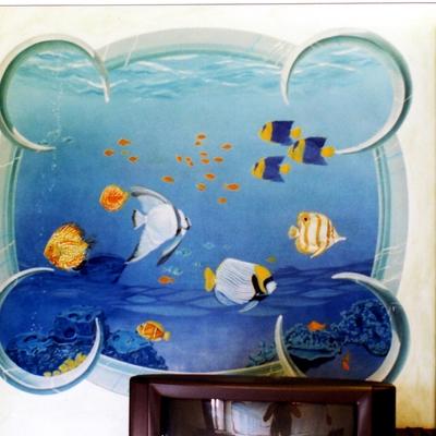 trompe de oil su parete aquario