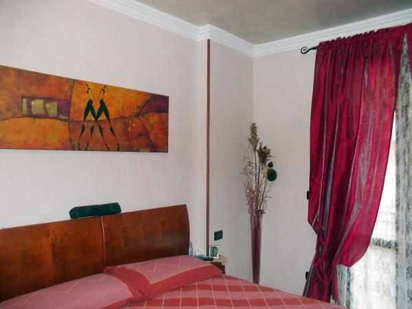 Foto camera da letto in stucco veneziano di artigiano for Camere in stile artigiano
