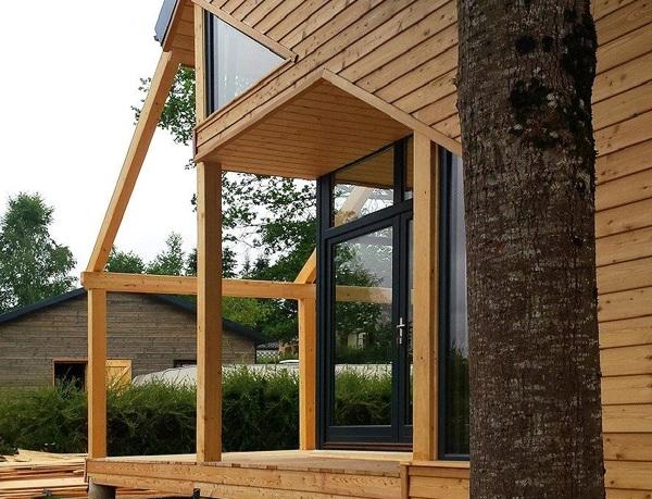 Foto case in legno di casa natura o m company 359283 for Garage pont de salars
