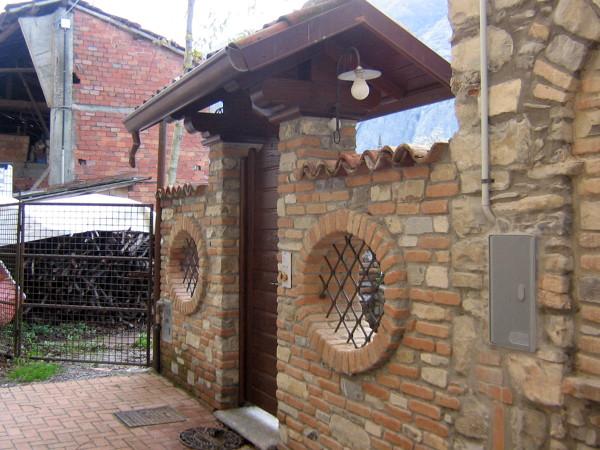 Foto fantasia in mattoni e pietra naturale di bava for Rivestimento in mattoni per case
