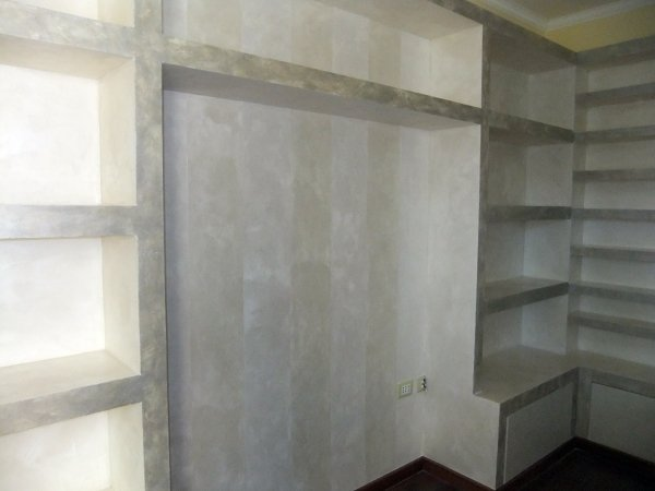 Foto libreria porta cd angolare in cartongesso con sportelli in legno di nova fatm srl 103235 - Parete in cartongesso con porta ...