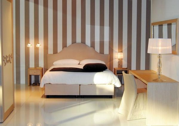 foto particolare letto arredo camera hotel di mar mobili