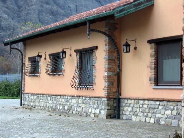 Foto particolari esterni in mattoni e pietra naturale di for Rivestimento in mattoni per case