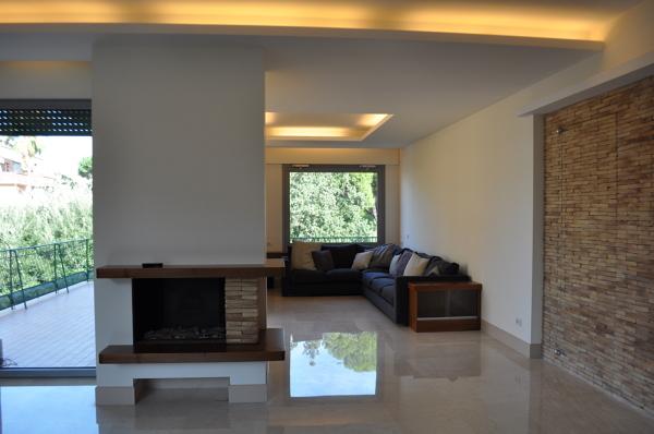Arredo soggiorno moderno con camino idee per il design - Soggiorni con camino ...