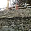 Muro in cemento armato rivestito in pietra
