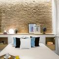 Camera da letto con mattoni a vista