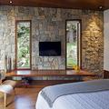 parete in pietra camera da letto