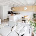 uno spazio unico per il salotto, la sala da pranzo e la cucina