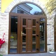 Chiusura porticato con porte scorrevoli e centine