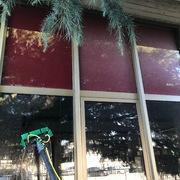Pulizia vetrate ad altezza 12m.