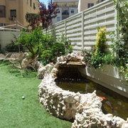 Laghetto per carpe koi stile informale giardino con for Lago tartarughe
