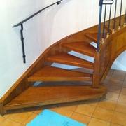 Scala in acciaio rivestita in legno