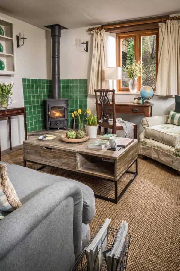 Stile cottage per una casa vacanze nella natura idee for Case modulari in stile bungalow