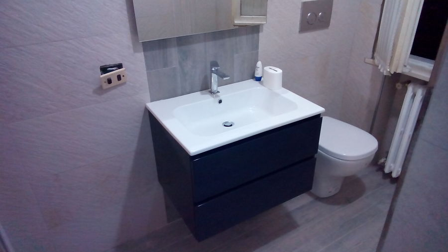 Foto: Bagno In Travertino Orizzontale con Gres Porcellanato In ...