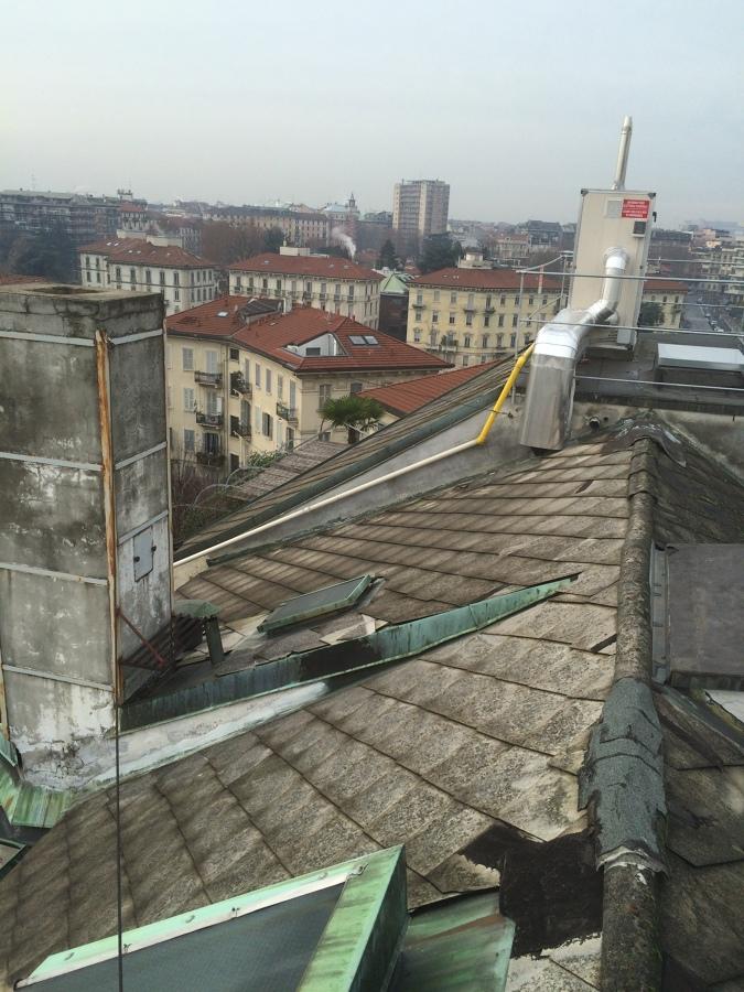 Ristruturazione tetto edificio idee tetti for Copertura piastrelle