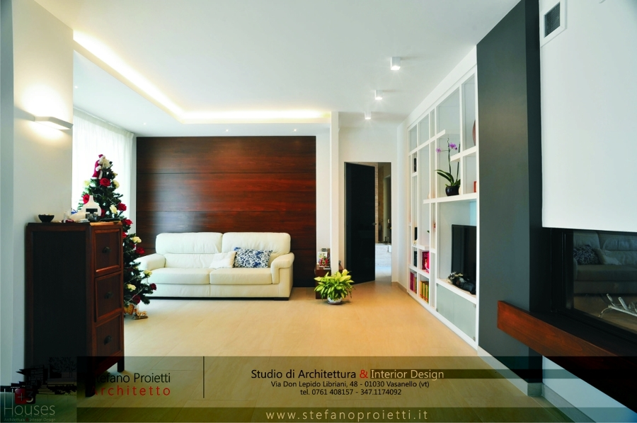 Progetto di un interno con camino centrale nella zona for Designer d interni